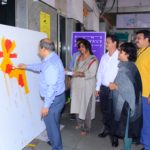 Mr. B.K. Dadahbhoy, Divisional Railway Manager painting canvas at the in...